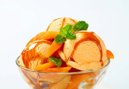 icecream: Ice cream with fresh apricot and caramel sauce Stock Photo