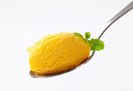 Yellow ice cream on a spoon photo