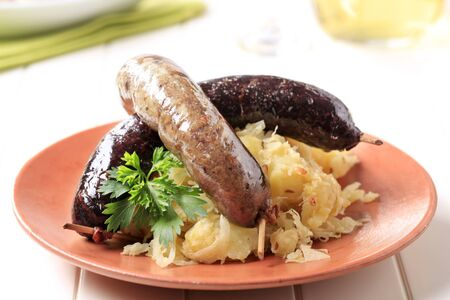 Blood sausage and white pudding with sauerkraut and potatoes Reklamní fotografie