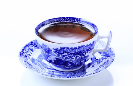Hot tea in an ornate teacup - studio photo