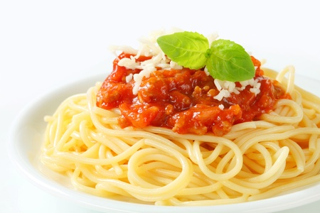 Spaghetti with meat-based tomato sauce and cheese photo