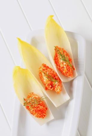 endive: Red lentil salad served on fresh endive leaves