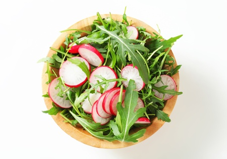 radish: Bowl of rocket salad and sliced radish