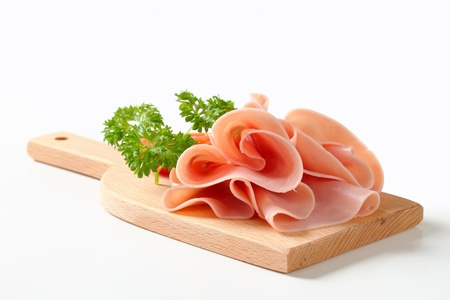 Thinly sliced ham on cutting board Banco de Imagens - 20258971