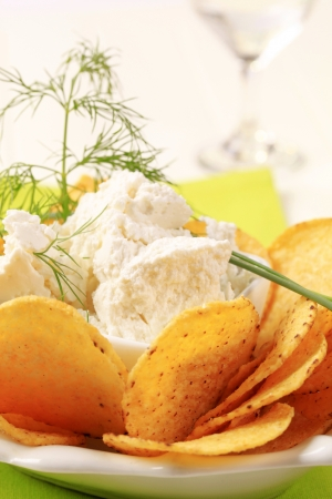 tortilla chips: Bowl of tortilla chips and curd cheese