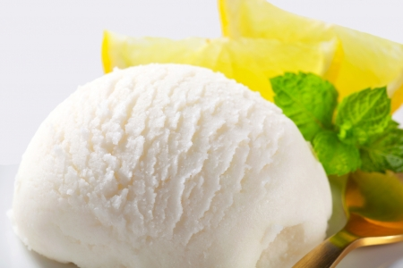 Scoop of lemon ice cream photo