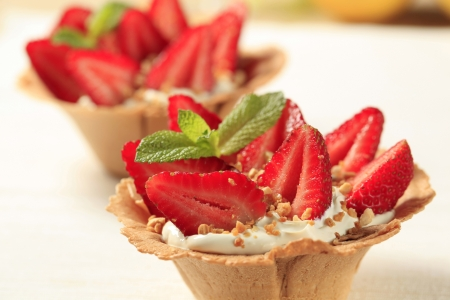 tartlet: Pastry cups filled with cream and fresh strawberries