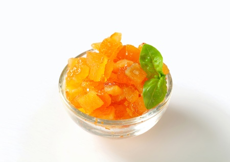 Candied citrus peel in a glass bowl photo