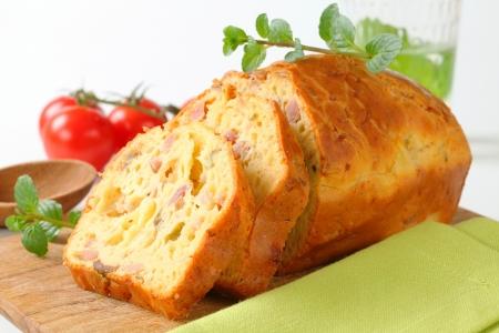 Slices of savory ham and olive cake Stock Photo