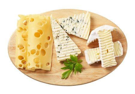 cheeseboard: Variety of cheeses on a cutting board