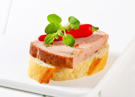 meat loaf: Slice of spicy meat loaf on crispy bread roll Stock Photo
