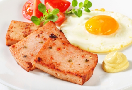 Pan-fried meatloaf with sunny side up fried egg and mustard Stock Photo - 20536165