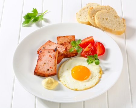 sunny side up: Pan-fried meatloaf with sunny side up fried egg and mustard
