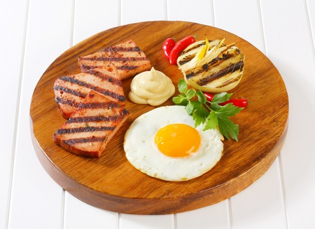 meatloaf: Grilled meatloaf with sunny side up fried egg and mustard Stock Photo