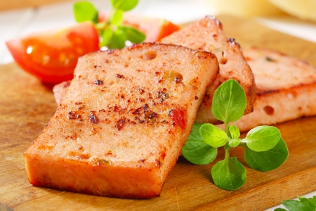 Pan-fried slices of German style meatloaf  Stock Photo - 20536211