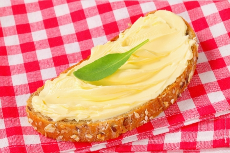 Slices of whole grain bread with butter photo