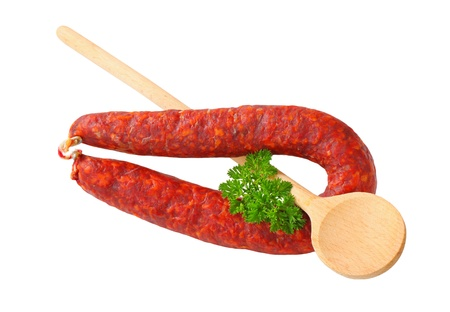 dry sausage: Spicy dry sausage and wooden  spoon