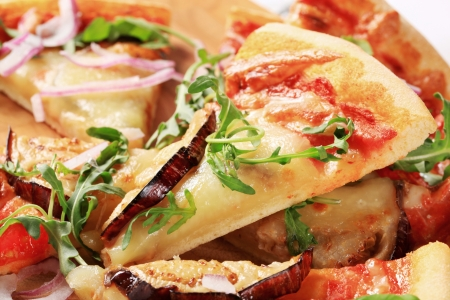 Slices of eggplant and cheese pizza photo
