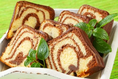 Slices of marble cake with chocolate icing