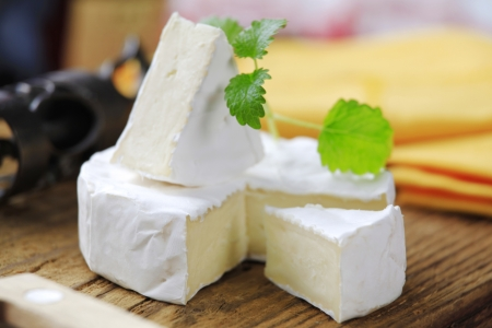 Soft cheese covered with edible white mold photo