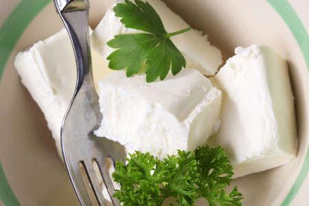 unripened: Bowl of fresh soft cheese - studio Stock Photo