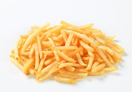 french fried potato: Fresh fried French fries - studio shot Stock Photo
