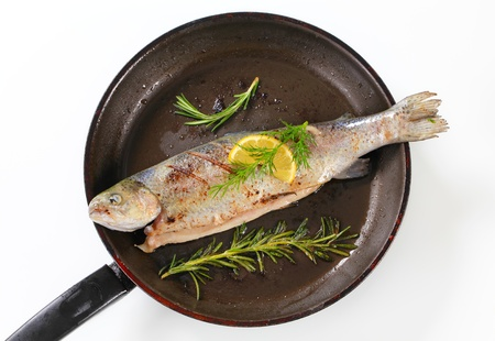 Grilled trout on a frying pan Stock Photo