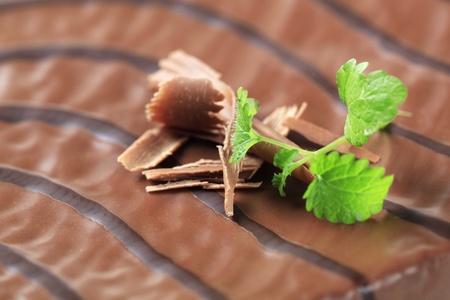 Macro shot of chocolate glaze on a cake photo