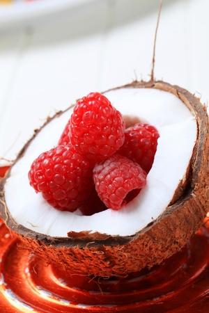 Fresh raspberries in a coconut shell - detail photo