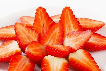 halved: Halved strawberries arranged on plate