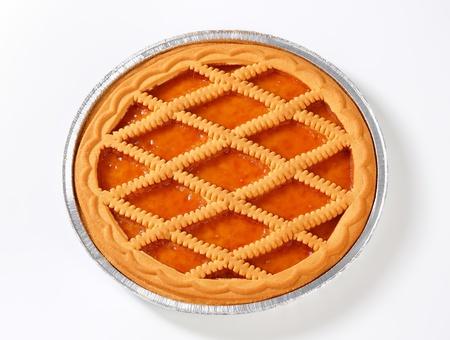 Lattice topped apricot tart in tin foil pan photo