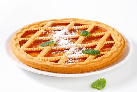 Round lattice topped apricot tart  photo
