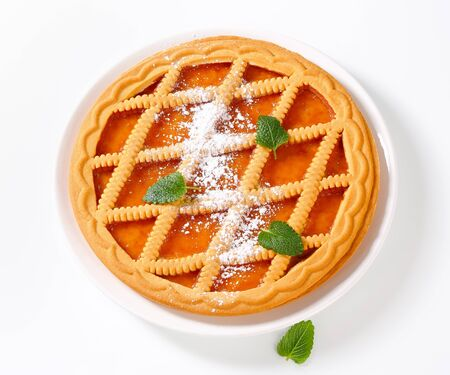 topped: Round lattice topped apricot tart  Stock Photo