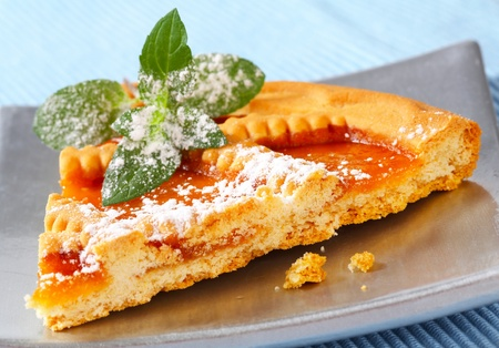 Slice of Linzer apricot tart photo