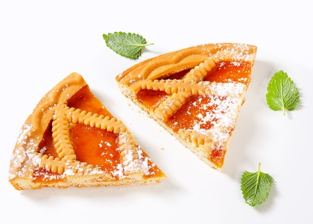 Slices of Linzer apricot tart photo