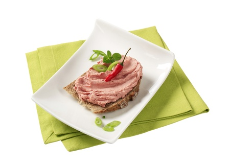 Slice of bread and smooth liver pate photo