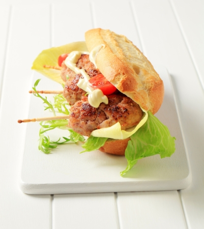 Crispy French bread with meatballs on sticks photo