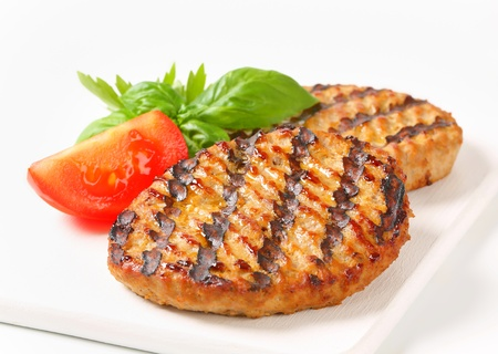 Grilled patties on cutting board photo