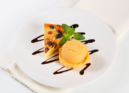 Almond cake with ice cream photo