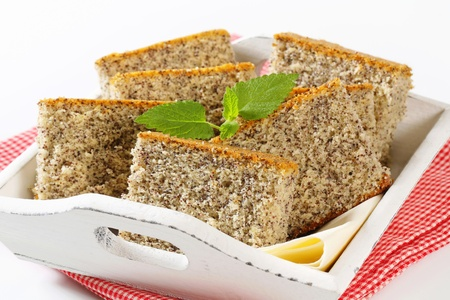 serving tray: Slices of poppy seed cake on wooden serving tray Stock Photo