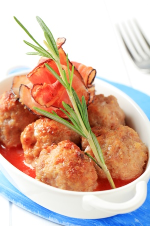 Meatballs with tomato sauce in a casserole dish photo