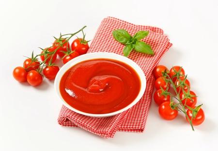 Bowl of smooth tomato passata Stock Photo