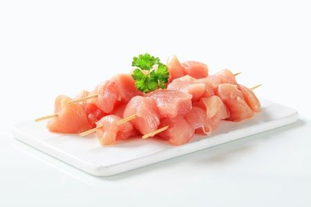 shish: Raw chicken skewers on cutting board Stock Photo