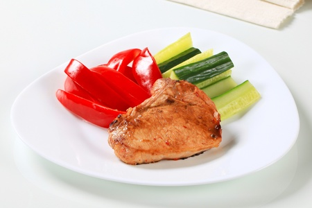 Glazed pork cutlet with fresh vegetables photo