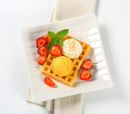mango fruit: Belgian waffle with fresh strawberries and ice cream