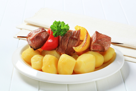 Grilled shish kebab with potatoes photo