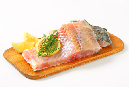 Raw carp fillets on cutting board Stock Photo - 22535005