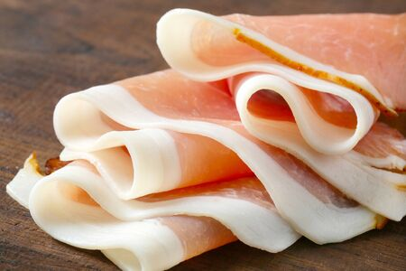 Delicious dry-cured ham sliced paper thin Stock Photo