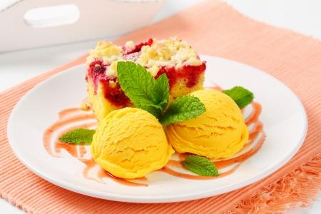 Piece of raspberry crumb cake with ice cream photo