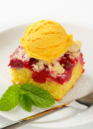 Piece of raspberry crumb cake with ice cream photo